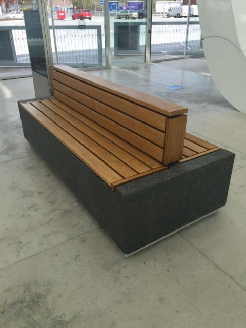 euroform w - sustainable urban furniture - organic, minimalist bench at train station - curved bench for outdoors - modular bench - seating island - sustainable seating furniture